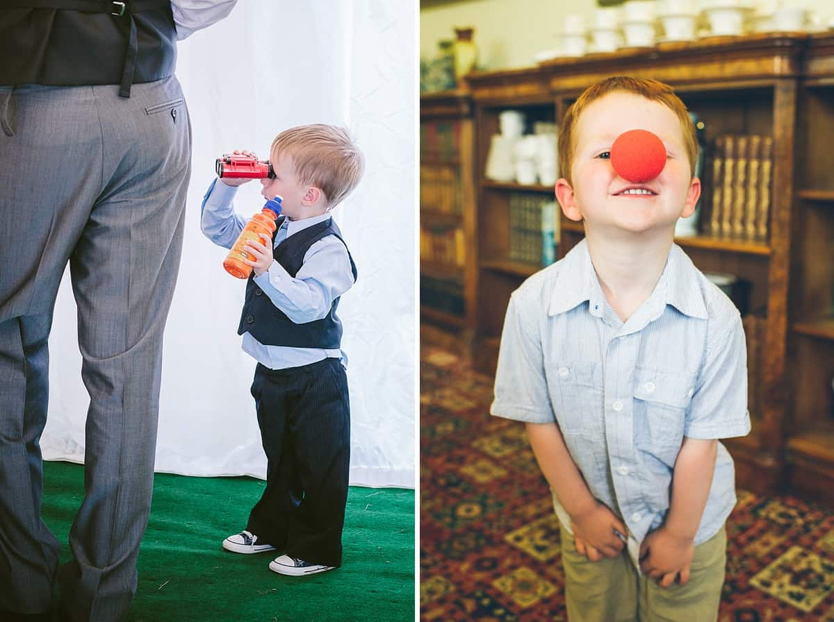 little boys playing with red noses and binoculars at a wedding