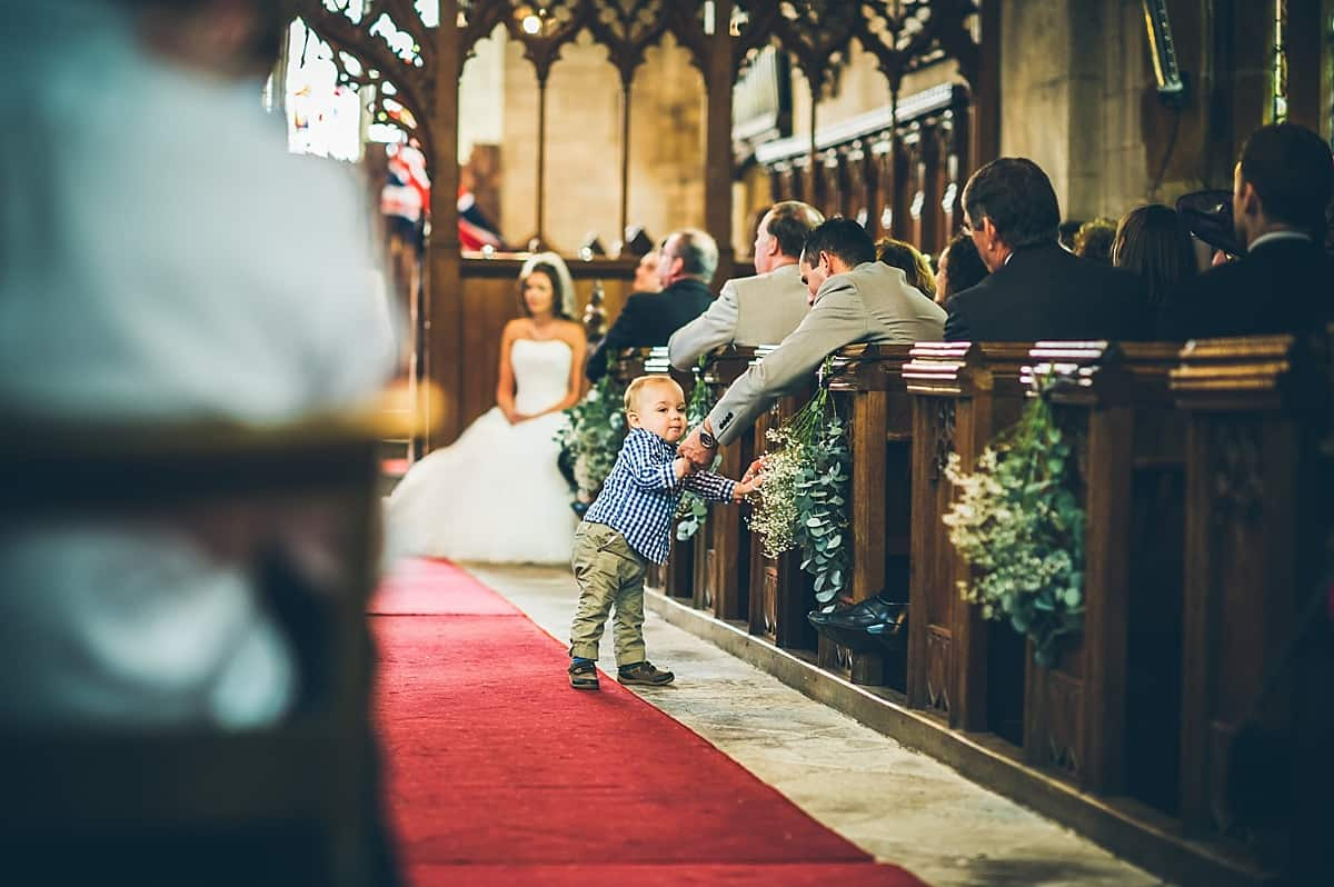 Little boy in the aisle during the service.