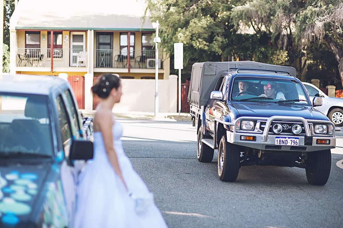 Car driving past shouting at the bride on a shoot!